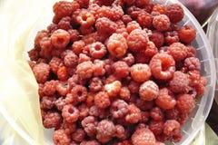 Fresh raspberries background closeup photo.  Stock Image
