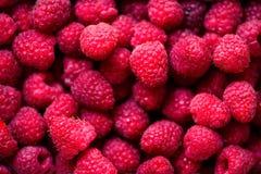Fresh raspberries background with copy space. Top view. Vegan and vegetarian concept. Summer healthy food. Macro of. Berries Stock Photo