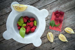 Fresh Raspberries With Basil And Lemon Stock Photography