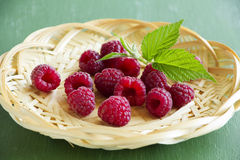 Fresh raspberries. In the basket Royalty Free Stock Photos