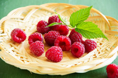 Fresh raspberries. In the basket Stock Images