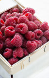 Fresh raspberries in basket. Closeup, selective focus Stock Photography