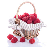 Fresh raspberries in a basket. On white Stock Images