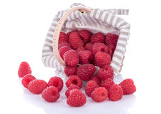 Fresh raspberries in a basket. On white Royalty Free Stock Image