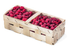 Fresh raspberries in the basket. On white background Stock Image