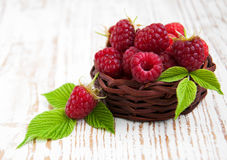 Fresh raspberries in the basket. On a wooden  background Stock Photography
