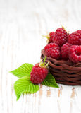 Fresh raspberries in the basket. On a wooden  background Royalty Free Stock Image