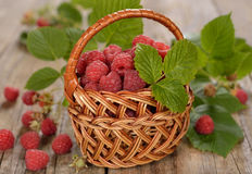 Fresh raspberries in a basket. On a wooden background Stock Photography