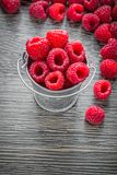 Fresh raspberries in basket on wooden board.  Stock Photography