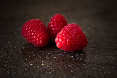 Fresh raspberries on a black background. Closeup. Fresh raspberries on a black background Stock Photos