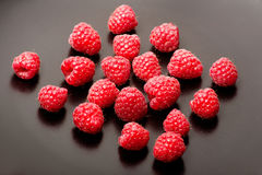 Fresh raspberries on black background. Closeup of Fresh raspberries on black background Stock Images