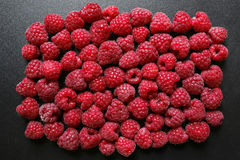 Fresh raspberries on black background. Juicy fresh raspberries on black background Stock Images