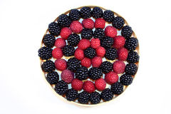 Fresh raspberries and blackberries. In a little dish, ordered in a circle Royalty Free Stock Image