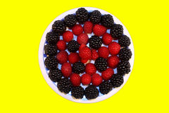 Fresh raspberries and blackberries. On the plate, isolated Stock Image