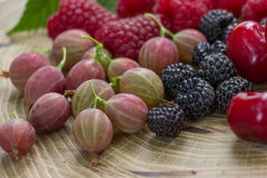 Fresh raspberries,  blackberries and gooseberry.  Royalty Free Stock Photos