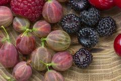 Fresh raspberries,  blackberries and gooseberry.  Royalty Free Stock Photography