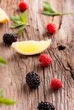 Fresh raspberries and blackberries. Fresh organic raspberries and blackberries Stock Photography