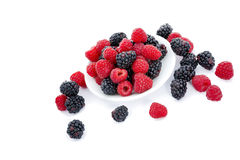 Fresh Raspberries and Blackberries on White. Berry fruit dish with fresh blackberries and raspberries, isolated on white Stock Photography