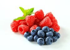 Fresh raspberries and blueberries Stock Photo
