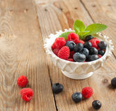 Fresh raspberries and blueberries. In bowl Stock Image