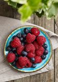 Fresh raspberries and blueberries. From above Stock Photos