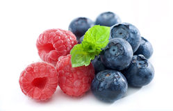 Fresh raspberries and blueberries isolated Stock Photos