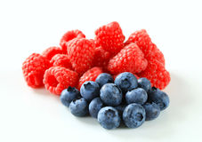 Fresh raspberries and blueberries. Studio shot of fresh raspberries and blueberries Royalty Free Stock Photo