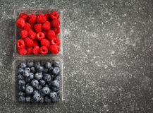 Fresh raspberries and blueberries. Top view, copy space Stock Photos