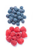 Fresh raspberries and blueberries, top view, isolated. On white Royalty Free Stock Photo