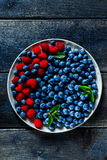 Fresh raspberries and blueberries Royalty Free Stock Image