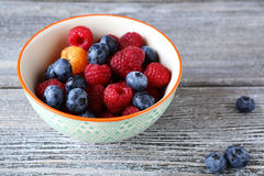 Fresh raspberries and blueberry in bowl. Fresh  raspberries  and blueberry  bowl, food closeup Stock Image
