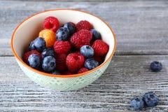 Fresh raspberries and blueberry in bowl. Fresh  raspberries  and blueberry  bowl, food closeup Stock Image