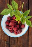 Raspberries in a rustic style. Fresh raspberries in a bowl in a rustic style Stock Photos