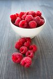 Fresh raspberries. In a bowl on a table Royalty Free Stock Photography