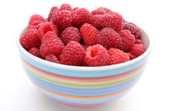 Fresh raspberries with a bowl on a white background. Fresh raspberries in a bowl isolated on a white background Stock Images