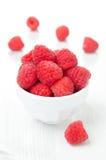 Fresh raspberries in a bowl Stock Photos