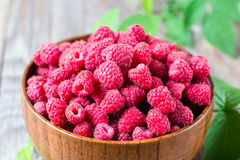 Fresh Raspberries in bowl on wooden table Stock Photos