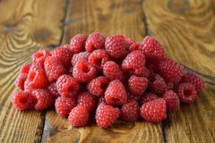 Fresh raspberries. On a brown background Royalty Free Stock Images