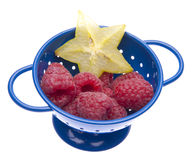Fresh Raspberries and Carambola Starfruit Royalty Free Stock Photography