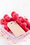 Fresh raspberries and cardboard tag Royalty Free Stock Photos