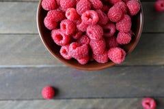 Fresh raspberries in a ceramic bowl. Food Stock Images