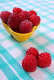 Fresh raspberries on checkered tablecloth, healthy food. Fresh raspberries on checkered tablecloth, concept of healthy food and dessert Stock Photo