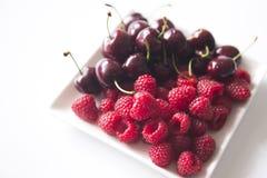 Fresh raspberries and cherries. On the dek Royalty Free Stock Photo