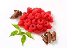 Fresh raspberries and chocolate curls. Heaps of fresh raspberries and chocolate curls Royalty Free Stock Image