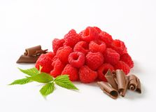 Fresh raspberries and chocolate curls. Heaps of fresh raspberries and chocolate curls Royalty Free Stock Photography