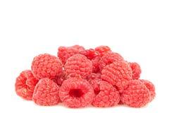 Fresh Raspberries Closeup. Red fresh Raspberries Closeup on a white background Royalty Free Stock Photo