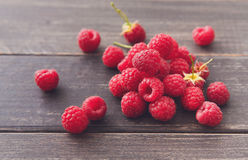 Fresh raspberries closeup on wood background Royalty Free Stock Photos