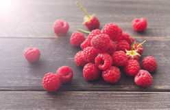 Fresh raspberries closeup on wood background. Fresh raspberries on wood background. Bowl with natural ripe organic berries closeup on wooden table Stock Photos