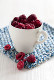 Fresh raspberries in cup Royalty Free Stock Image