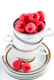 Fresh raspberries in a cup. Fresh raspberries in a coffee cup isolated on white background Royalty Free Stock Images